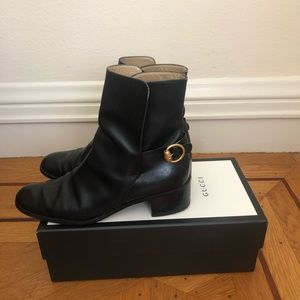 Gucci black leather boot with gold buckle. Sz 8.5